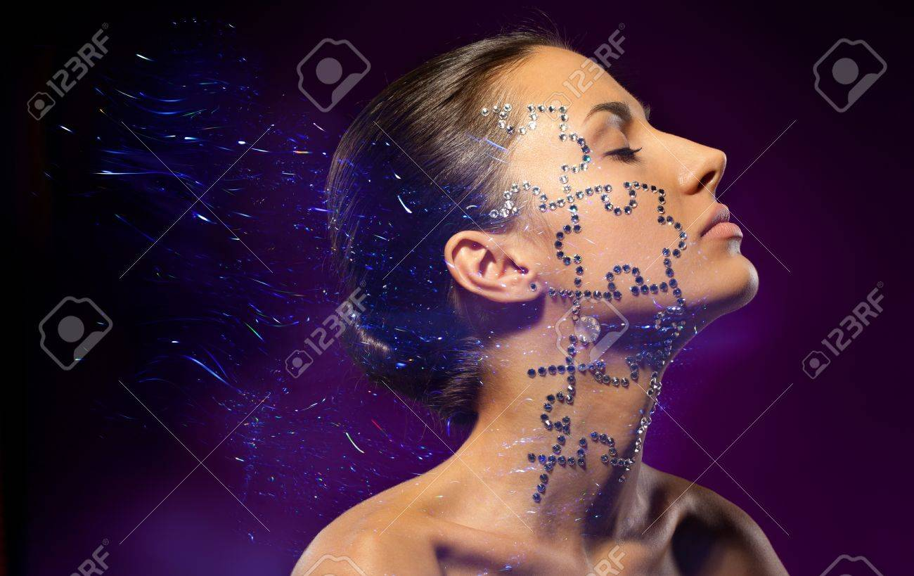 Fashion art portrait of female with beauty crystal puzzle on her face Stock Photo - 18303495