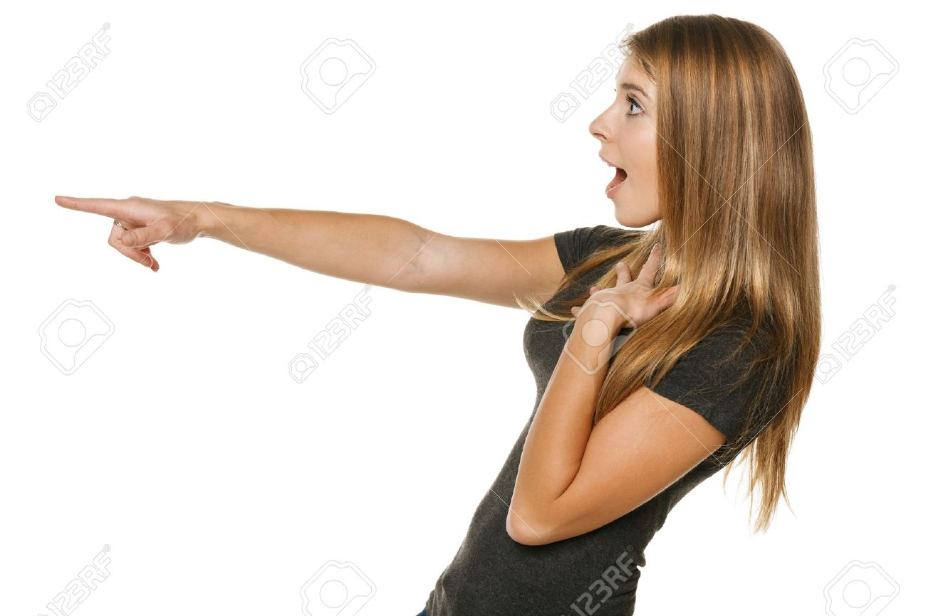 Side view of a excited casual female pointing out at copyspace, over white background Stock Photo - 18911281