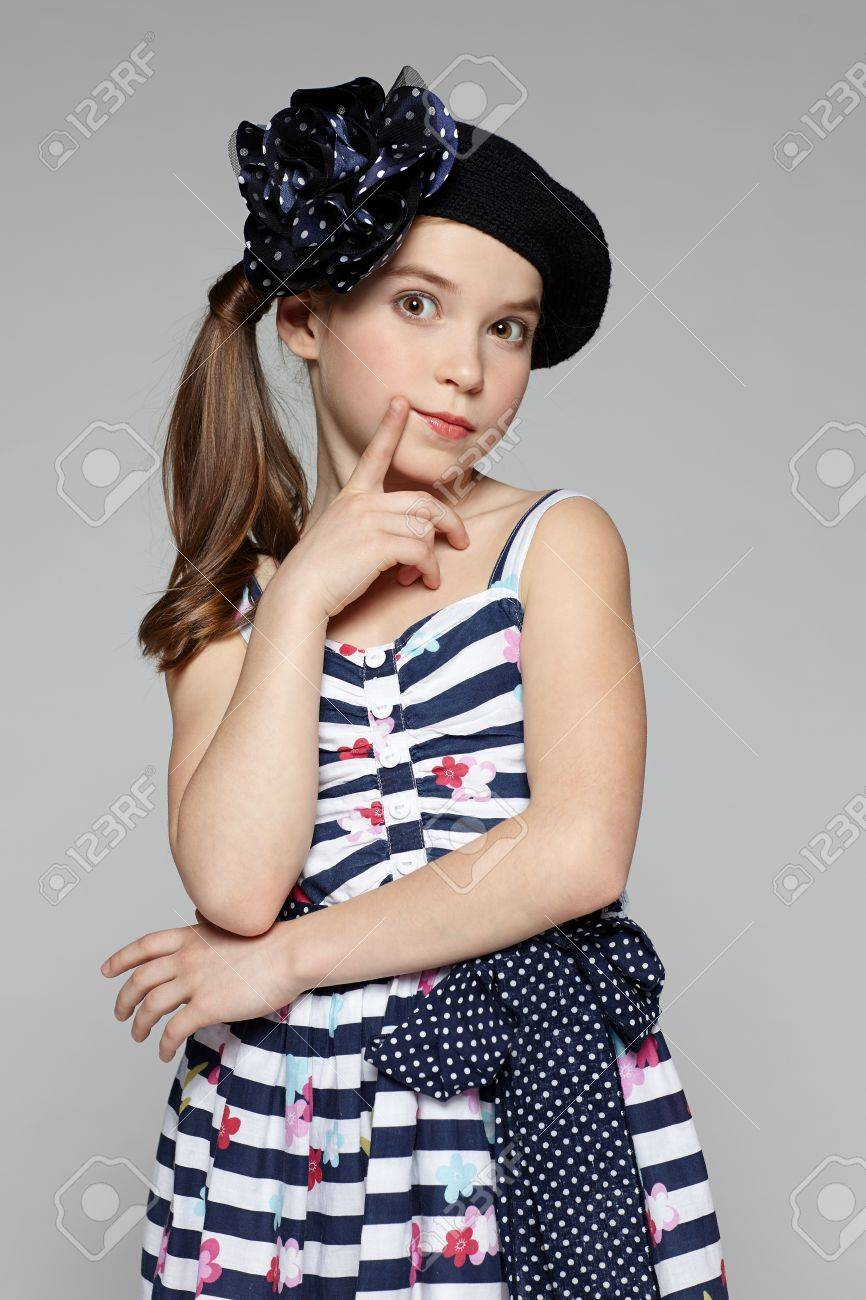 Surprised little girl wearing marine style dress Stock Photo - 18999868