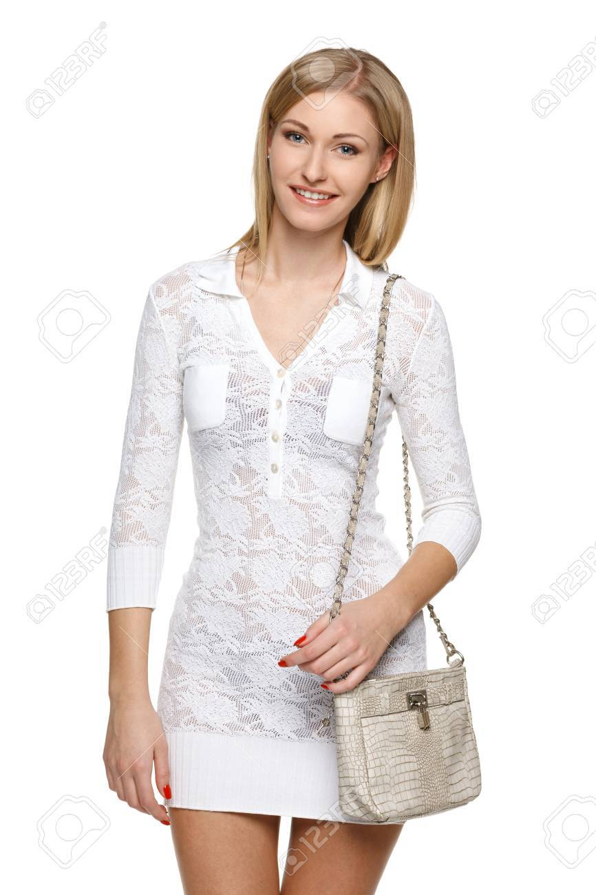 Smiling woman in white lacy dress with small handbag, over white background Stock Photo - 19203412