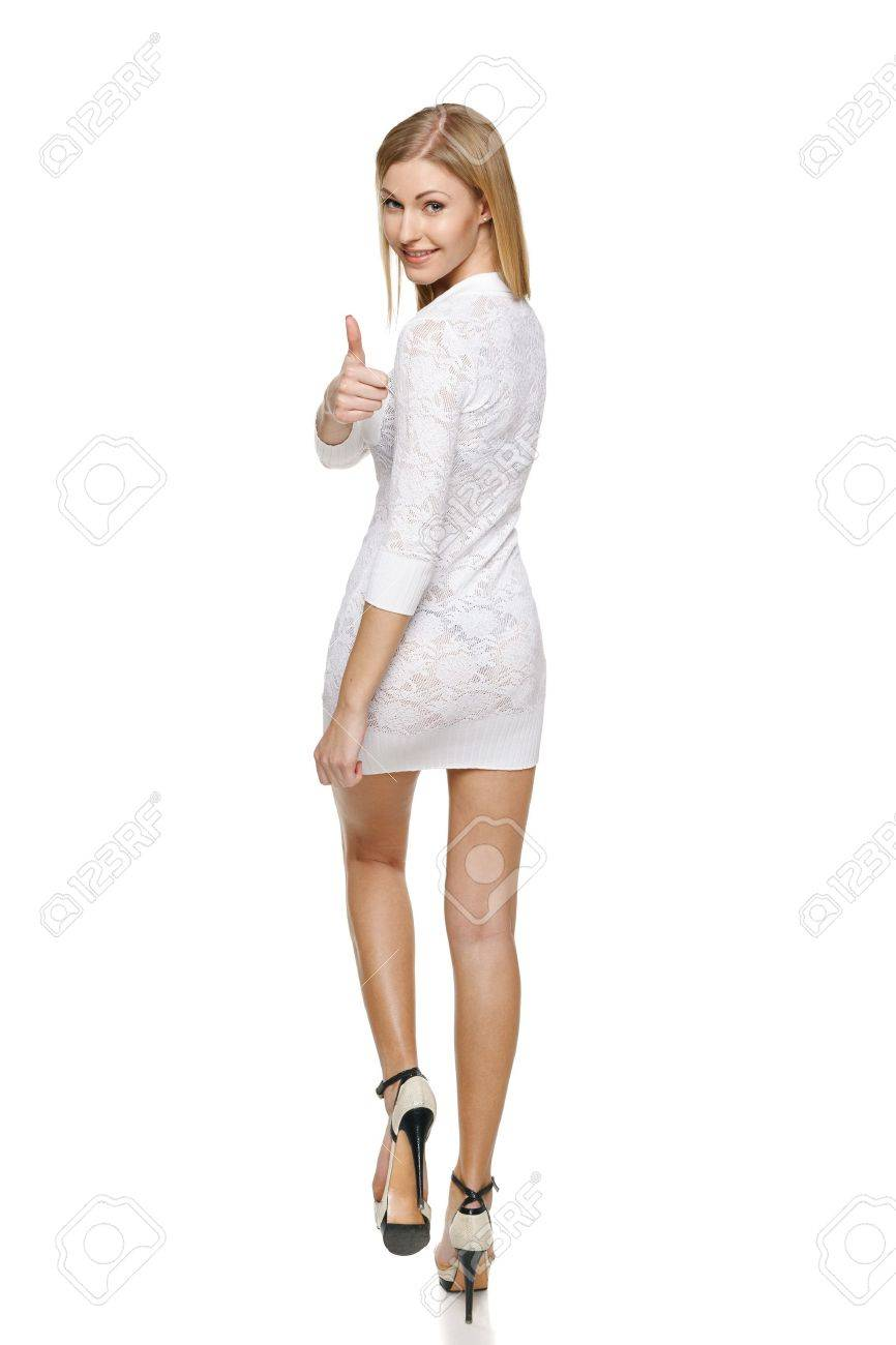 Full length of back view of walking woman showing thumb up sign over her shoulder Stock Photo - 19203394