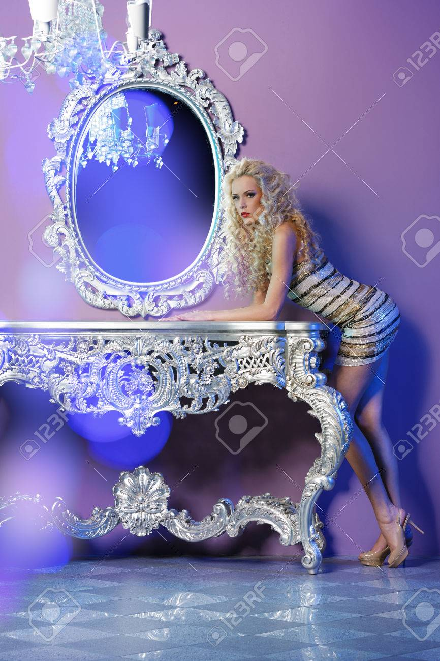 Portrait of fashion model posing in glamorous interior Stock Photo - 24867518