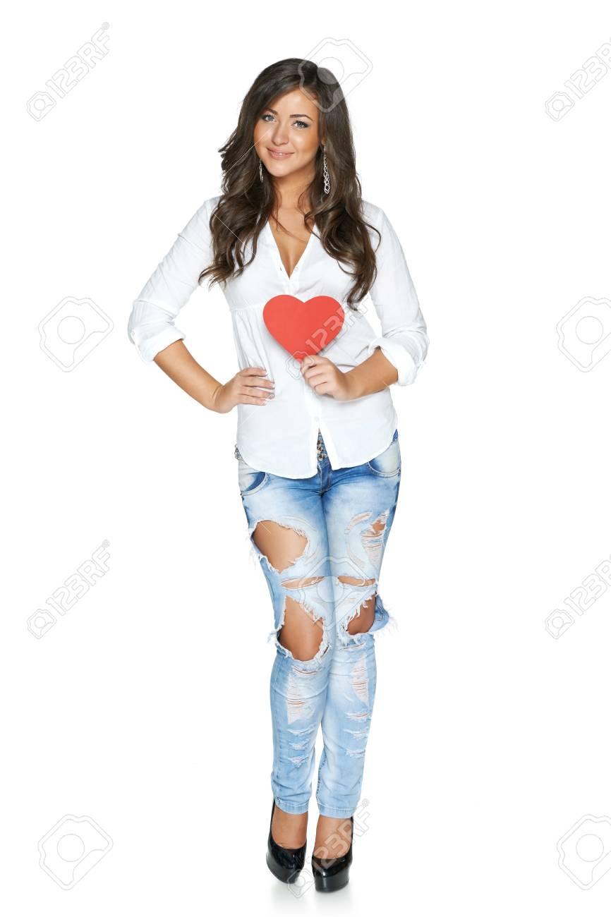 Mujer Integral En Jeans Rasgados Funky Y Camisa Blanca Mostrando El Corazon Aislado En El Fondo Blanco Fotos Retratos Imagenes Y Fotografia De Archivo Libres De Derecho Image 26365169