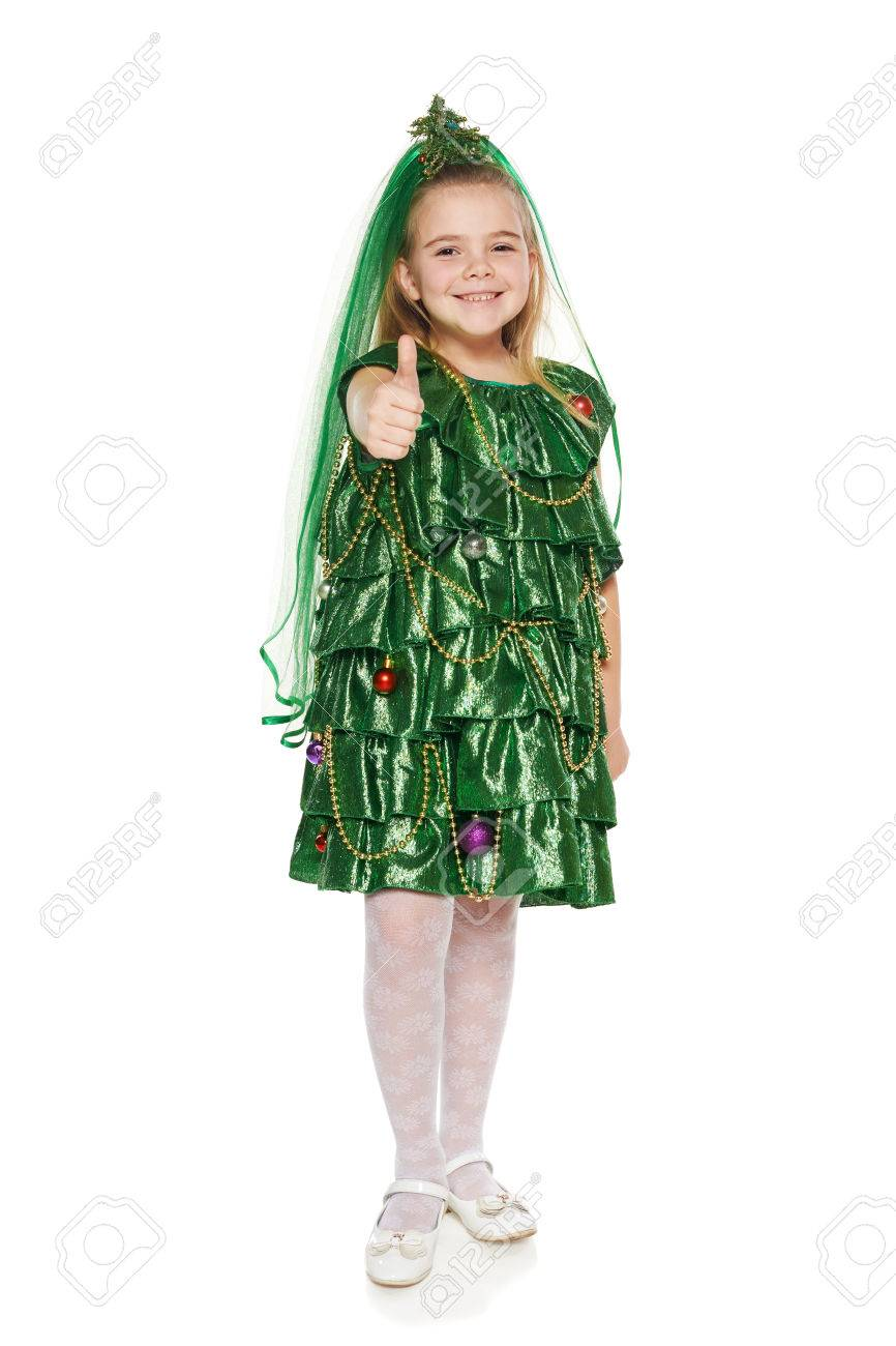 Happy 7 Years Old Girl In Christmas Tree Costume Giving You Thumb