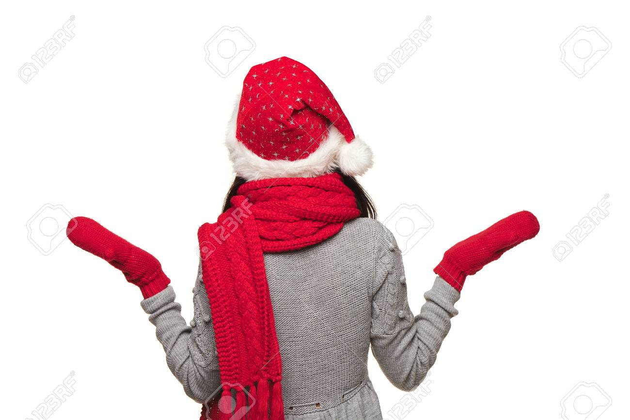 51408052352 Back view of Xmas woman wearing Santa hat looking at blank copy space and  shrugging her