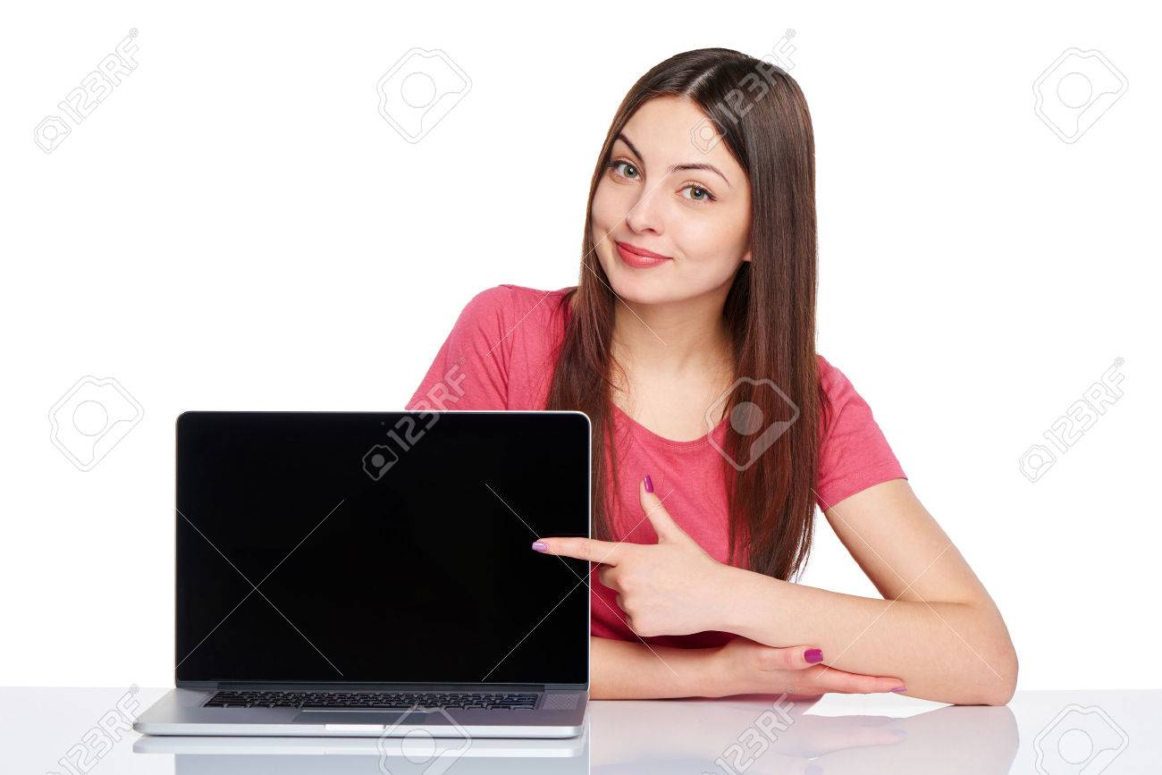 Happy woman pointing at a laptop computer screen, isolated over white - 40273318