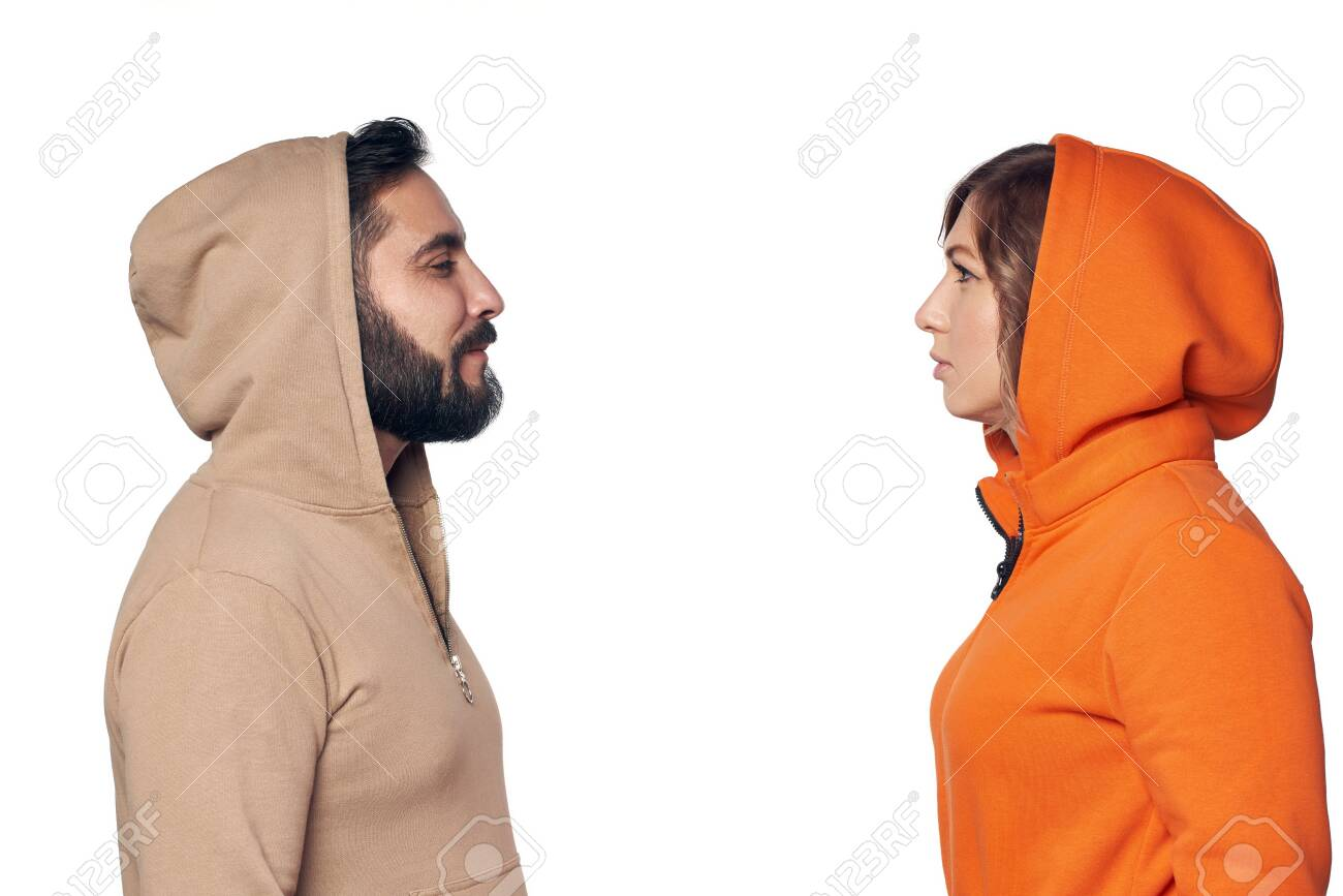 Young couple in casual clothes standing face to face looking at each other with intense - 124431473