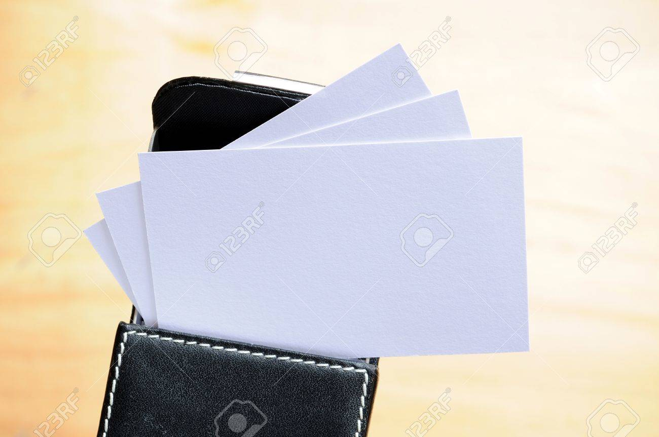Several Business Cards In A Leather Name Card Box Over A Background ...