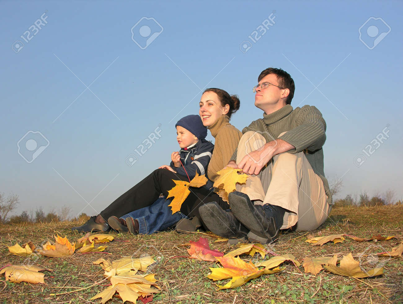 family sit with autumn leaves Stock Photo - 262330