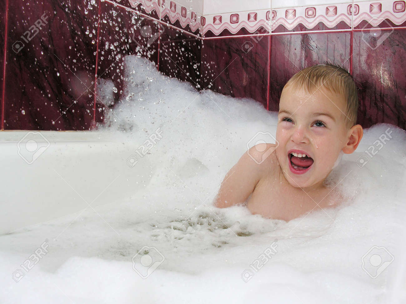 boy in bath hides from streem of water Stock Photo - 262188