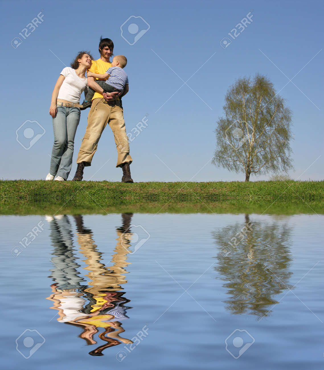 family stand with son. spring.water Stock Photo - 548144