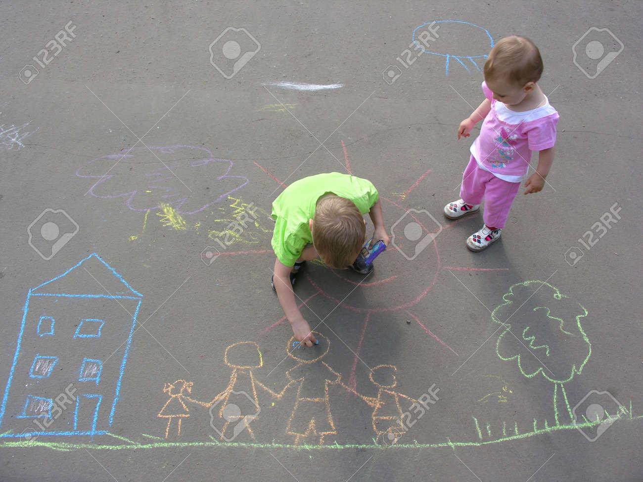 children drawing on asphalt family house Stock Photo - 547896