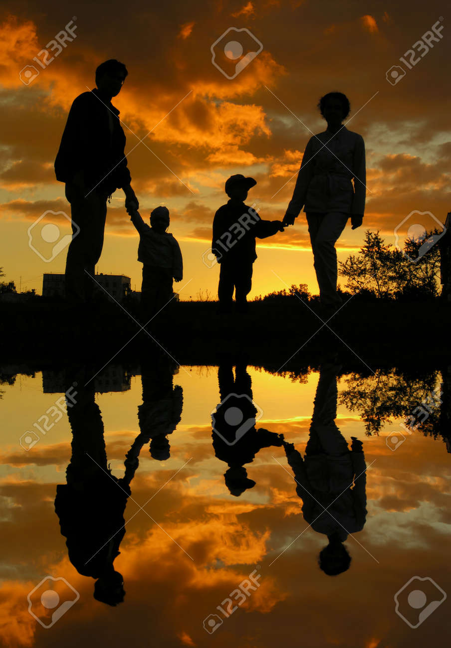 family of four sunset 2 and water Stock Photo - 547844