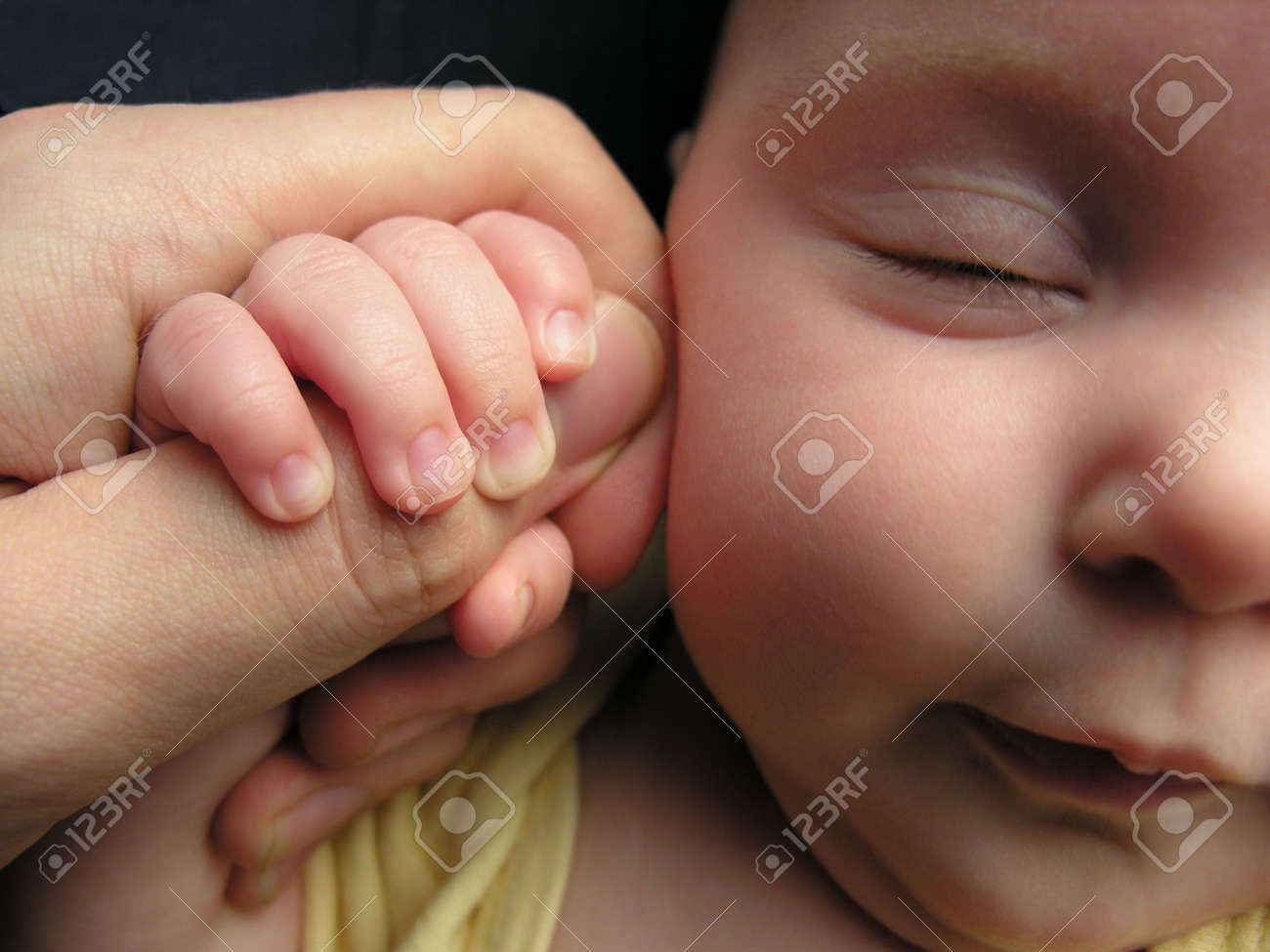 baby sleep with father's finger Stock Photo - 547787
