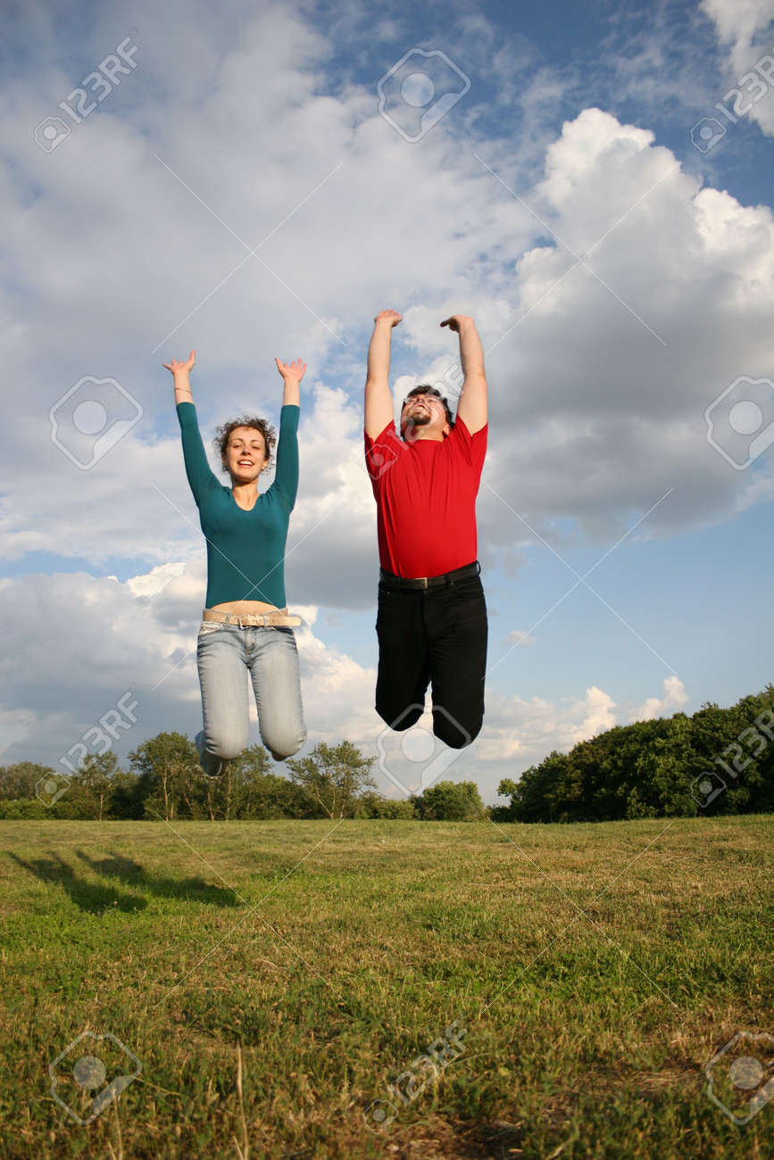 jump couple on meadow Stock Photo - 547610