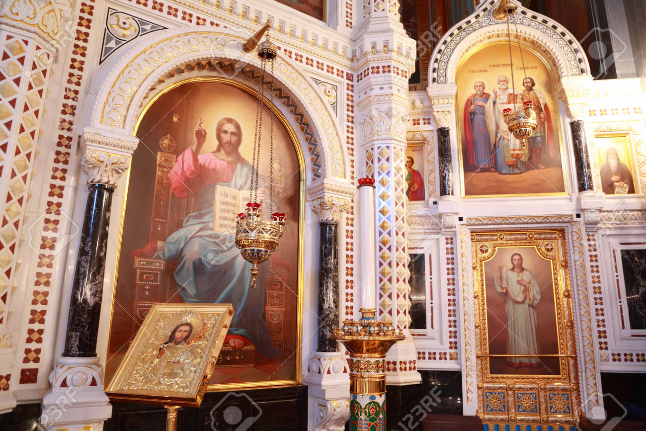Icons And Stand For Candles Near Painting In Arch Inside Cathedral