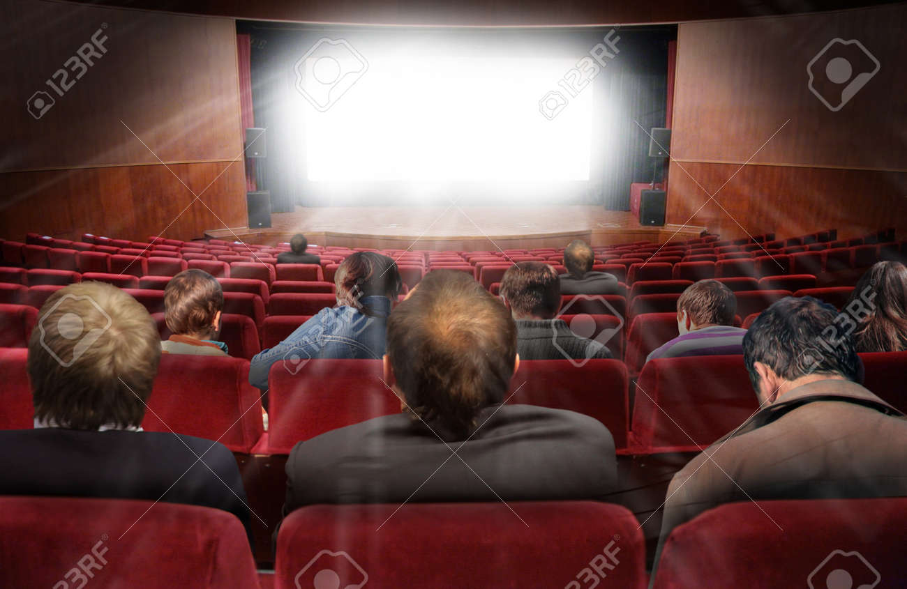 spectators in hall of cinema with movie collage Stock Photo - 17640323