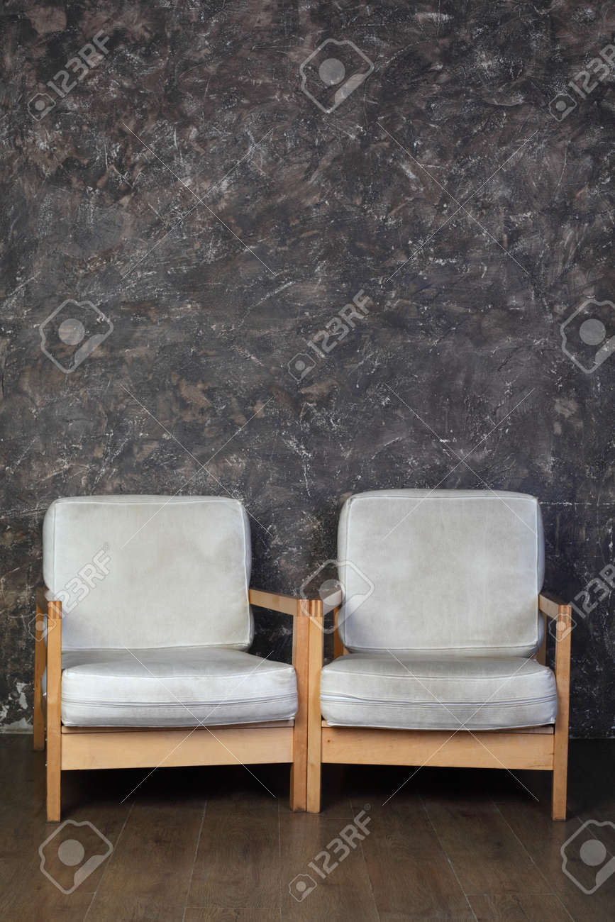 two white chairs in studio of photographer, brown background Stock Photo - 17643277