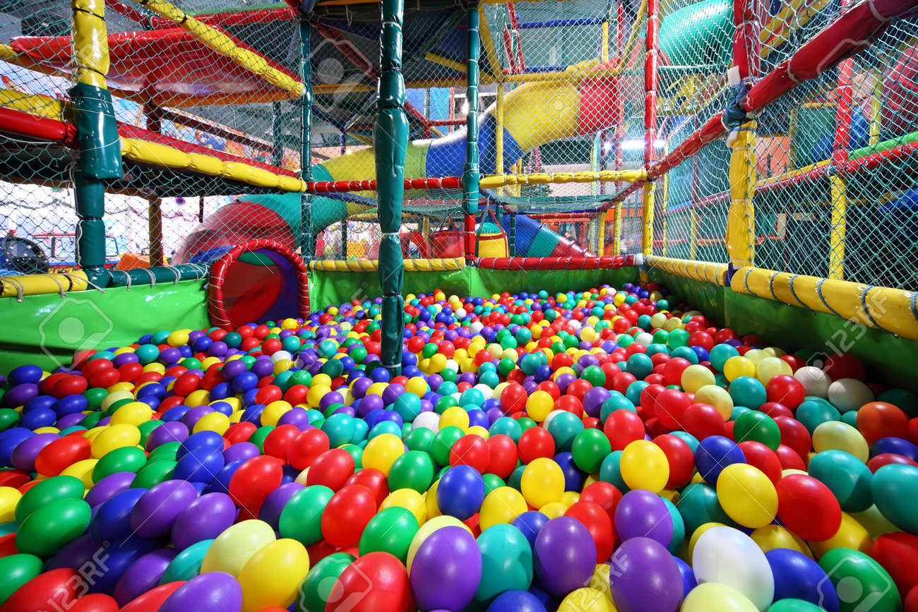Much varicoloured bright balls are poured in sector for slide from chute Stock Photo - 17662152