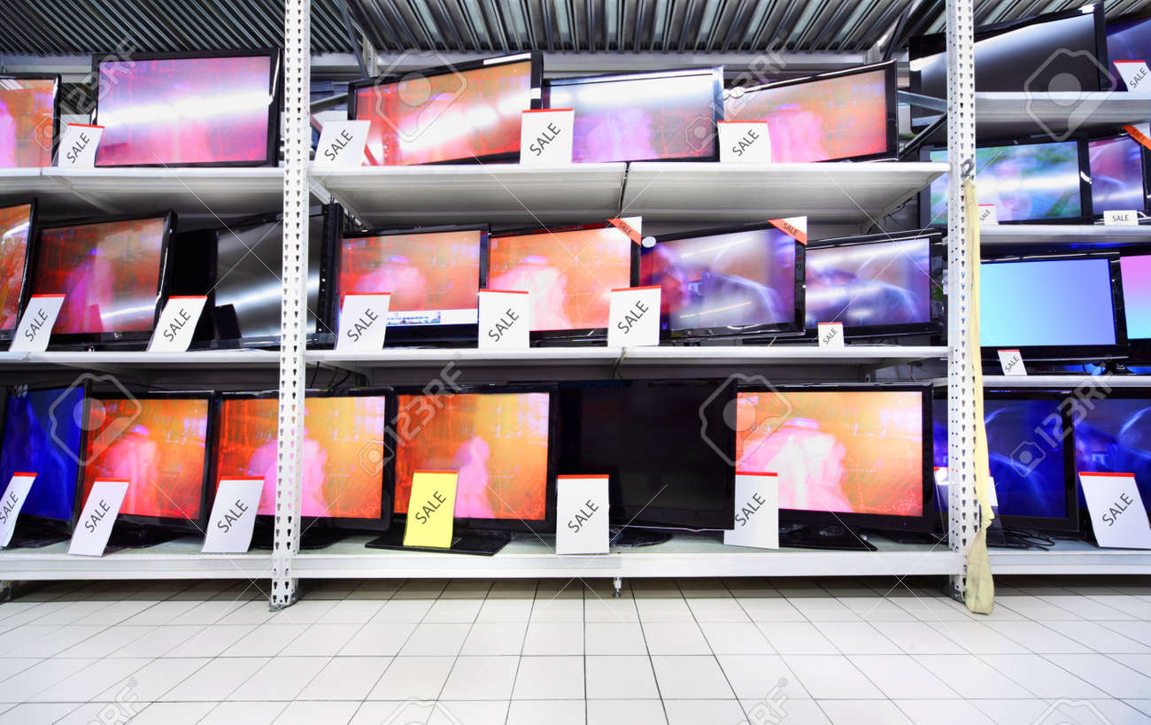Plasma TVs with big diagonal stand on shelves in large store; wide range Stock Photo - 17717695