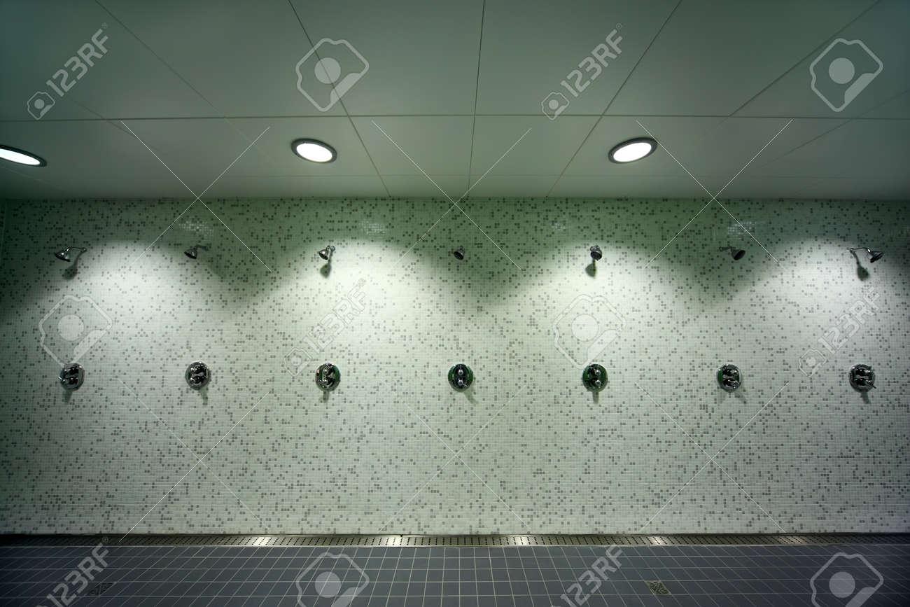 Big light empty public shower room green tile on walls gray big light empty public shower room green tile on walls gray floor dailygadgetfo Choice Image