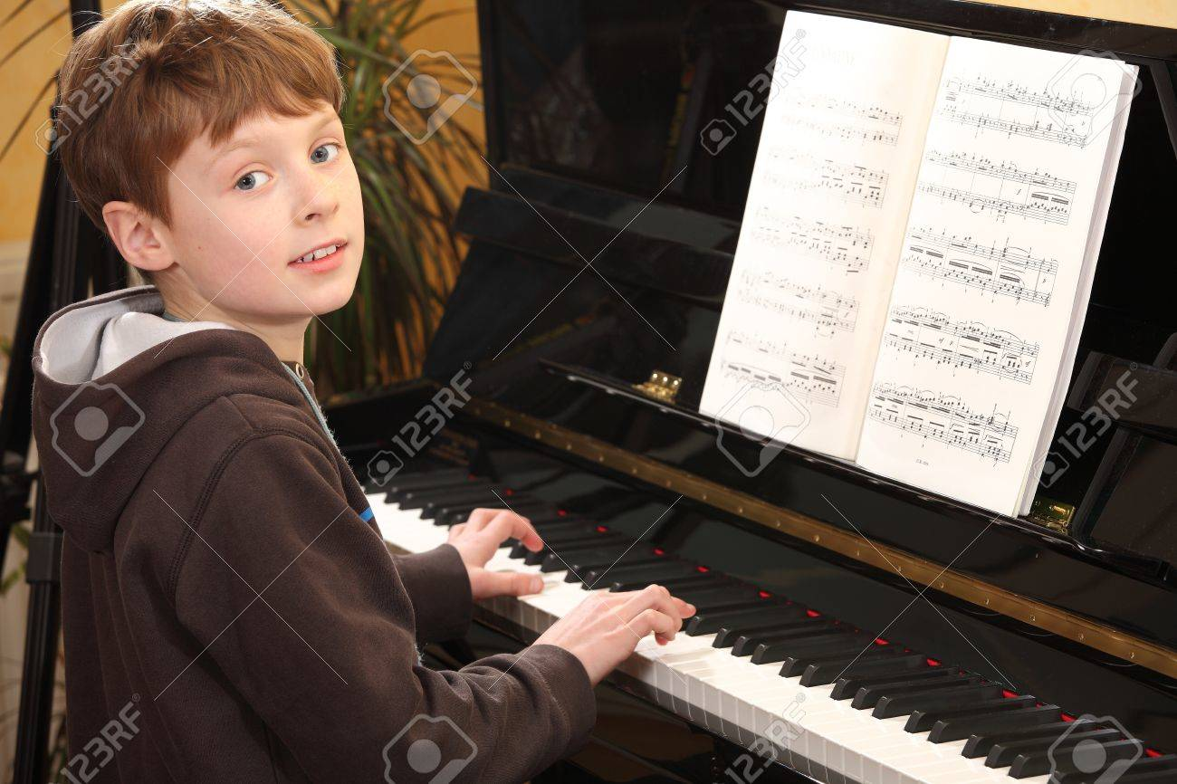Portrait of a young teenage boy playing piano Stock Photo - 8831425