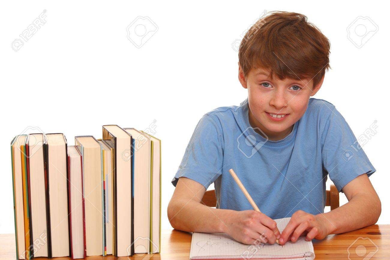 Portrait of a young boy doing his homework isolated on white background Stock Photo - 9031748