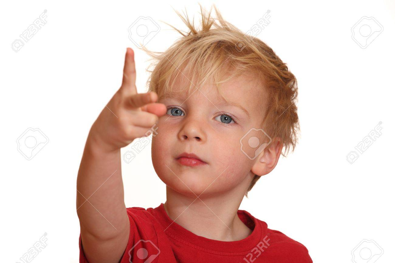 A cute little boy points with his fingers upward Stock Photo - 9325264
