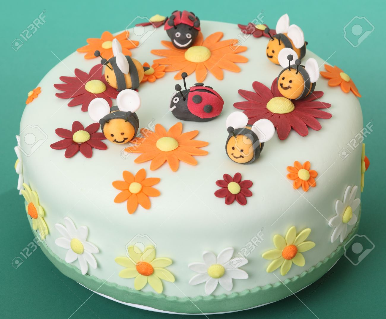 Birthday Cake With Flowers Sugar Bees And Ladybugs Stock Photo