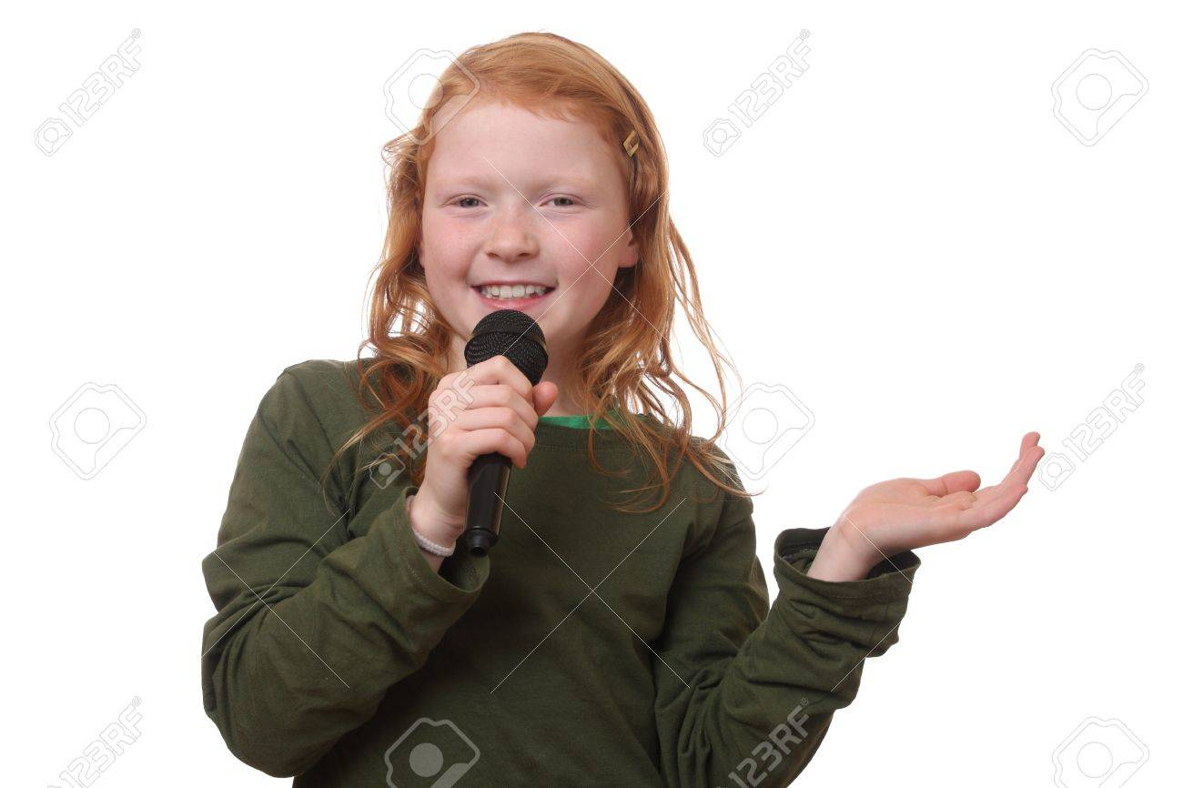 Young red haired girl with microphone on white background Stock Photo - 16690017