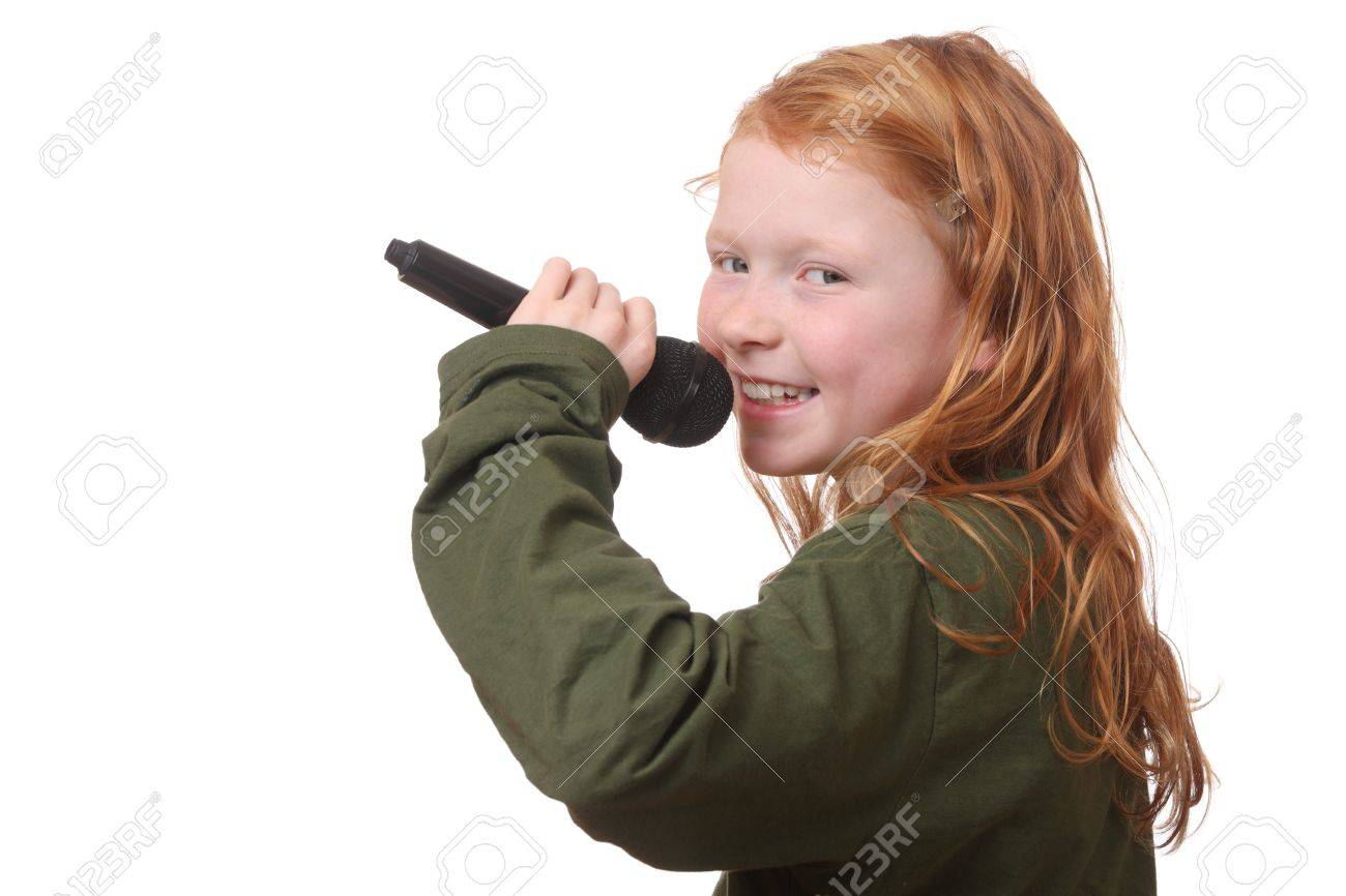 Young red haired girl with microphone on white background Stock Photo - 16690016