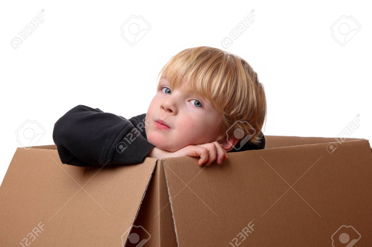 Portrait of a happy young toddler sitting in a box Stock Photo - 17330101