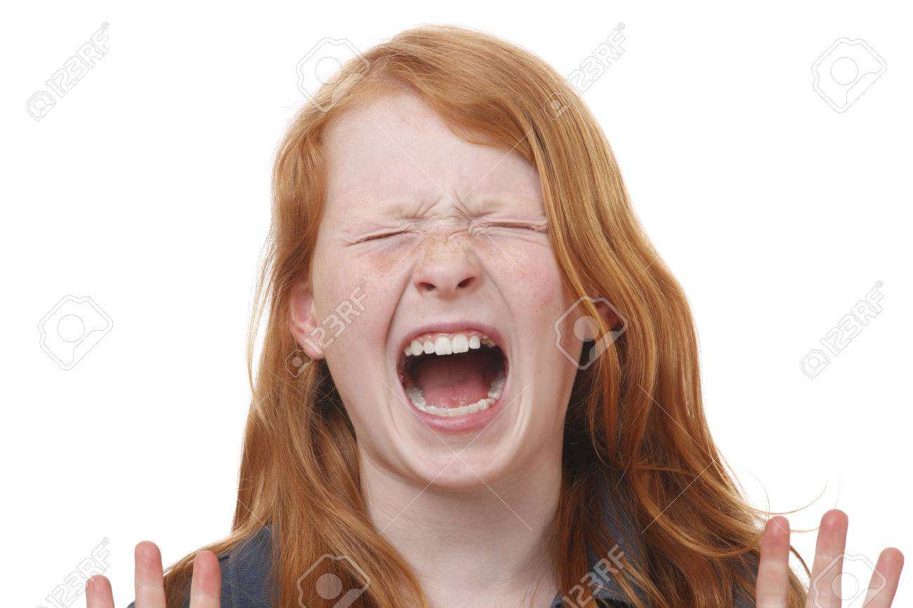 Portrait of a screaming young girl on white background Stock Photo - 27861745