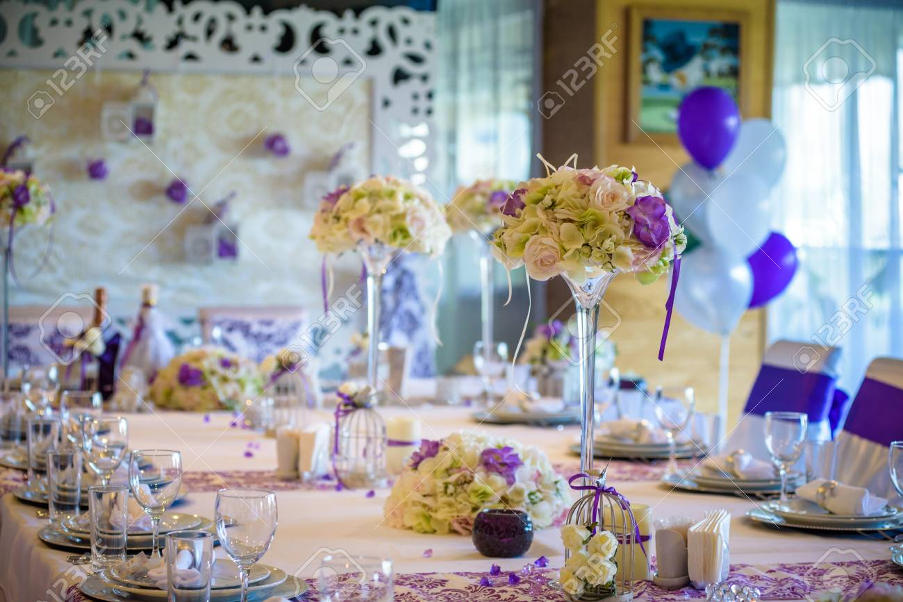 Stock Photo   Table Setting At A Luxury Wedding Reception. Example Of  Festive Decorating. Real Flowers On Table For Bride And Groom.