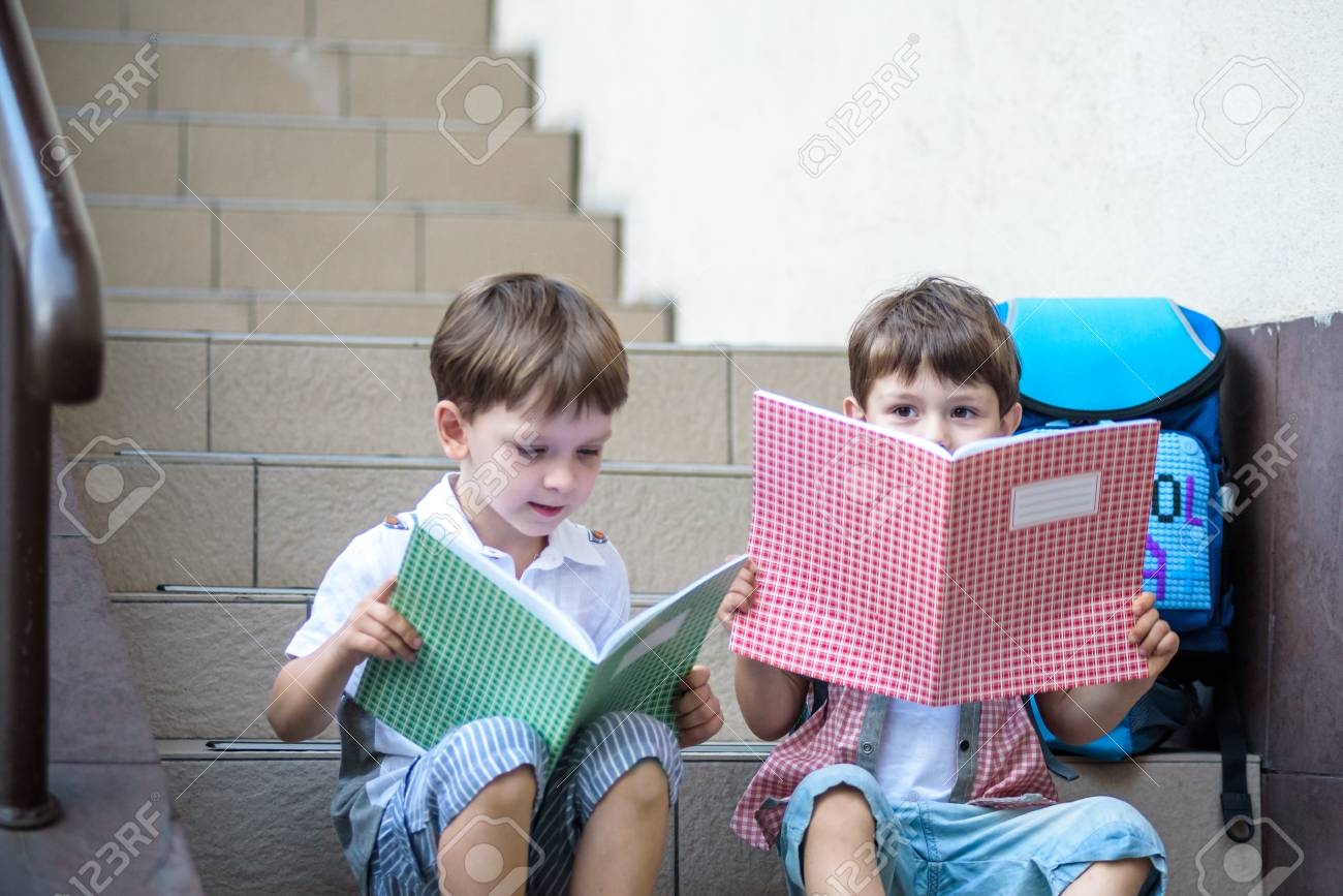 Children go back to school. Start of new school year after vacation. Two Boy 4abf6b84145c2