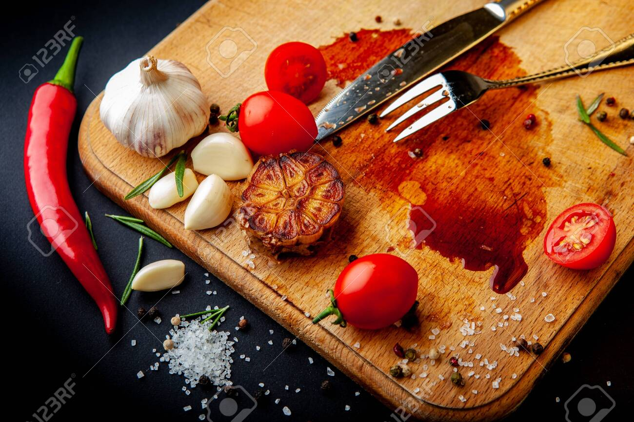 Empty cutting board after eaten steak with leftover food. - 146613535