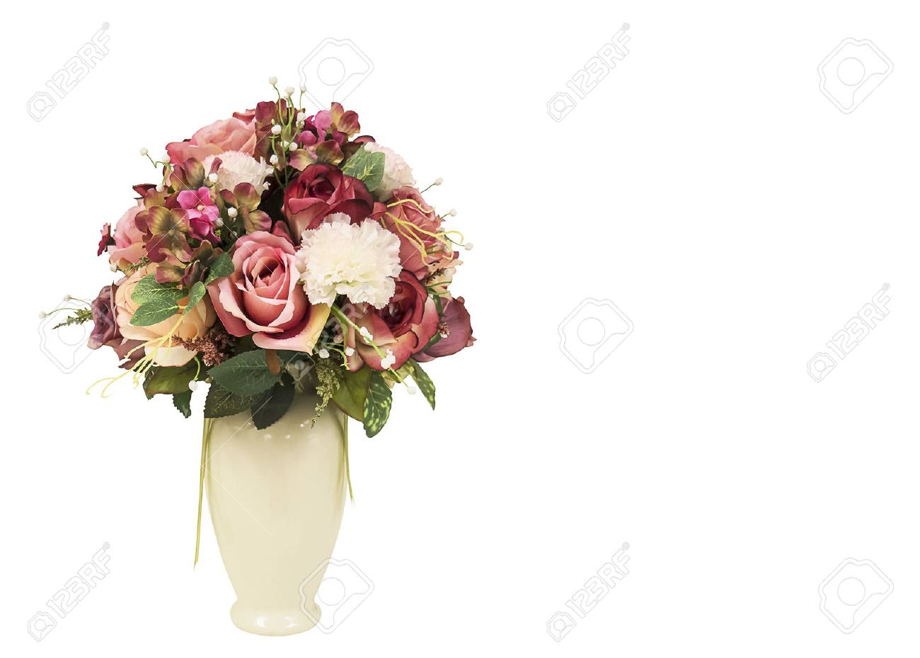 Artificial Flowers In The White Big Vase For Interior Decoration