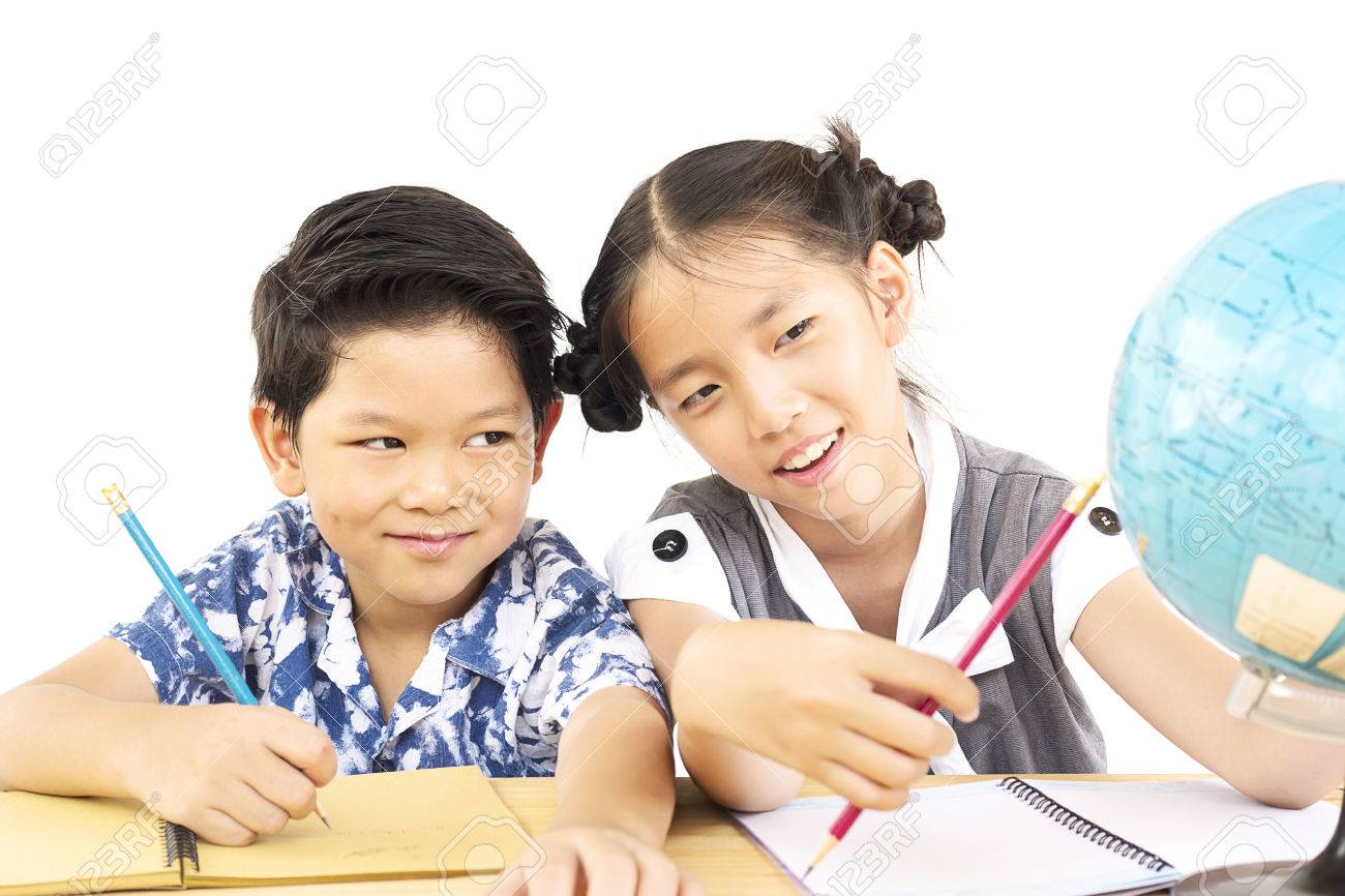 asian kids are studying the globe over white background stock photo