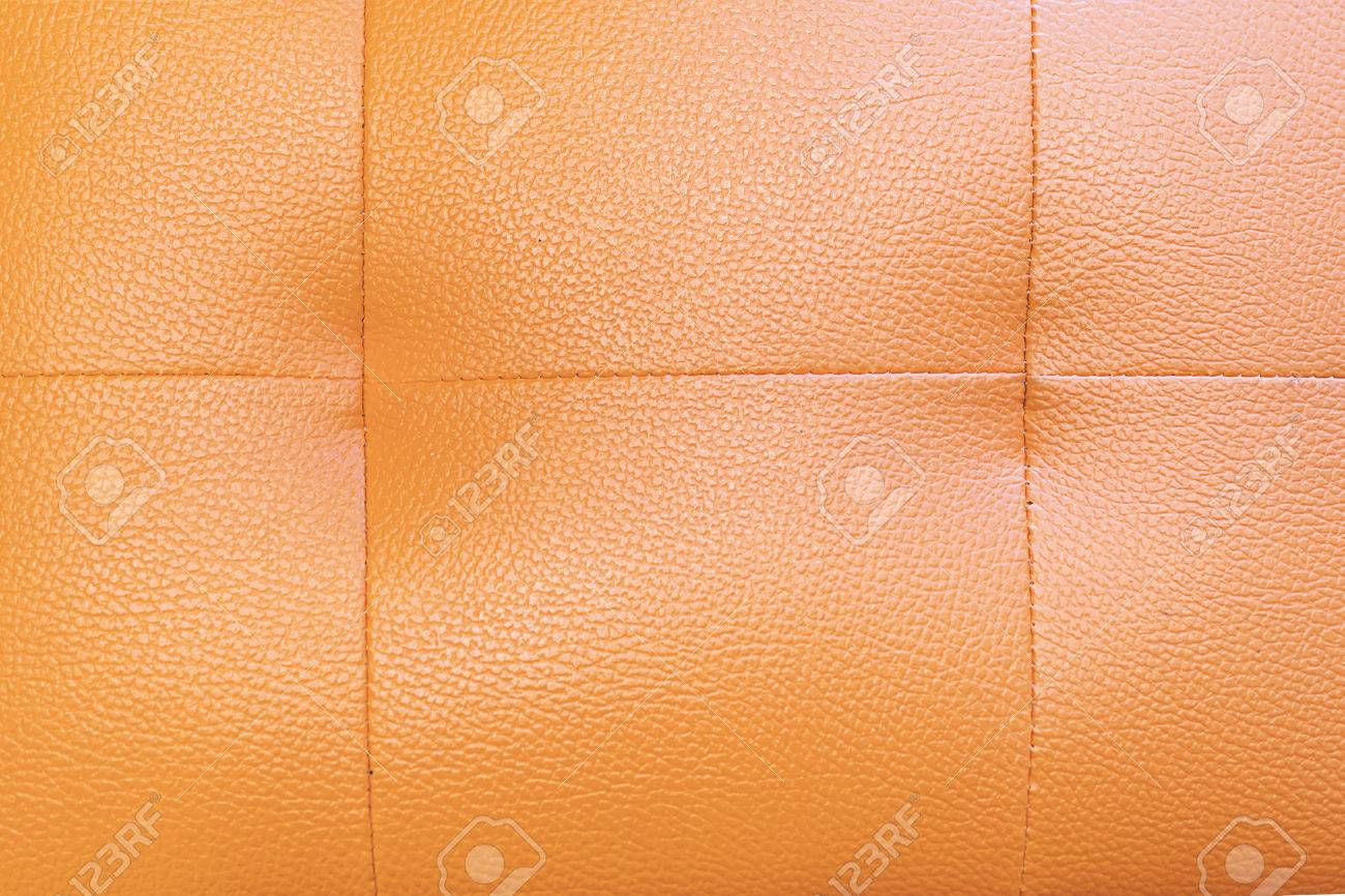 Orange sofa cover lather texture background