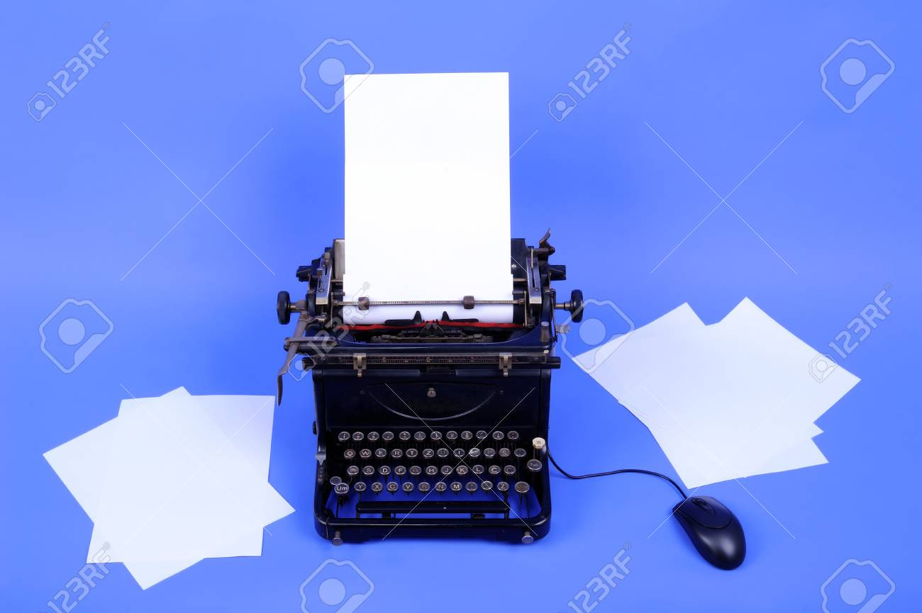 Vintage typewriter machine with computer mouse and loaded paper sheets Stock Photo - 9326018