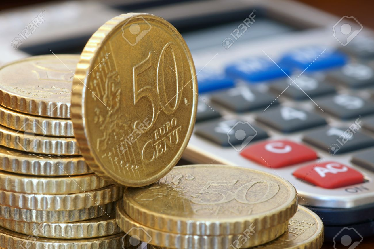 A Stack Of 50 Cents Euro Coins And A Calculator Stock P O 13585582