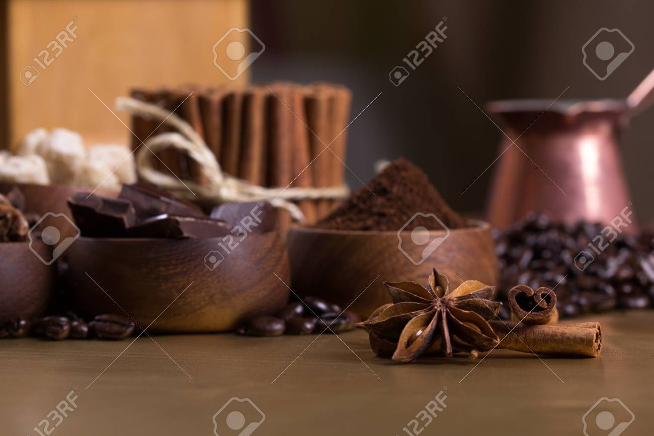 Wooden bowls with coffee beans, sugar, anise, chocolate  Cinnamon bunch, croissant and cup of coffee Stock Photo - 20870501