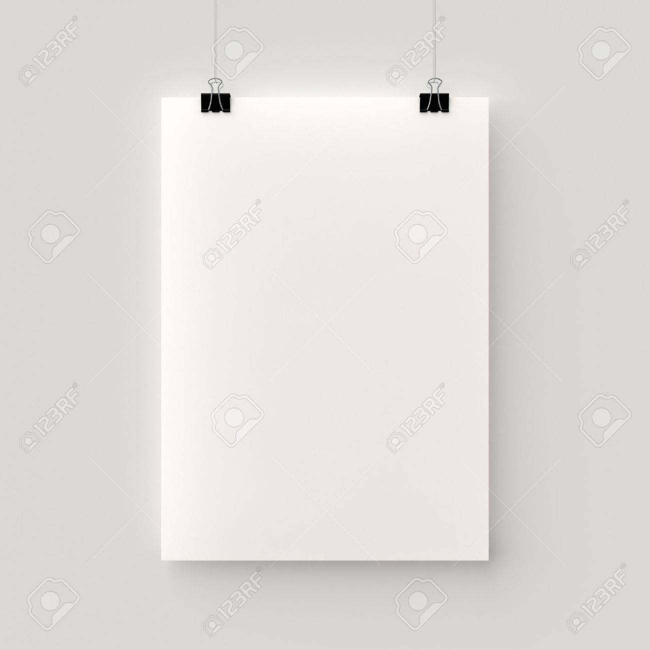 Poster Hanging On A Thread With Two Black Clips Blank Sheet Of Paper  Against A