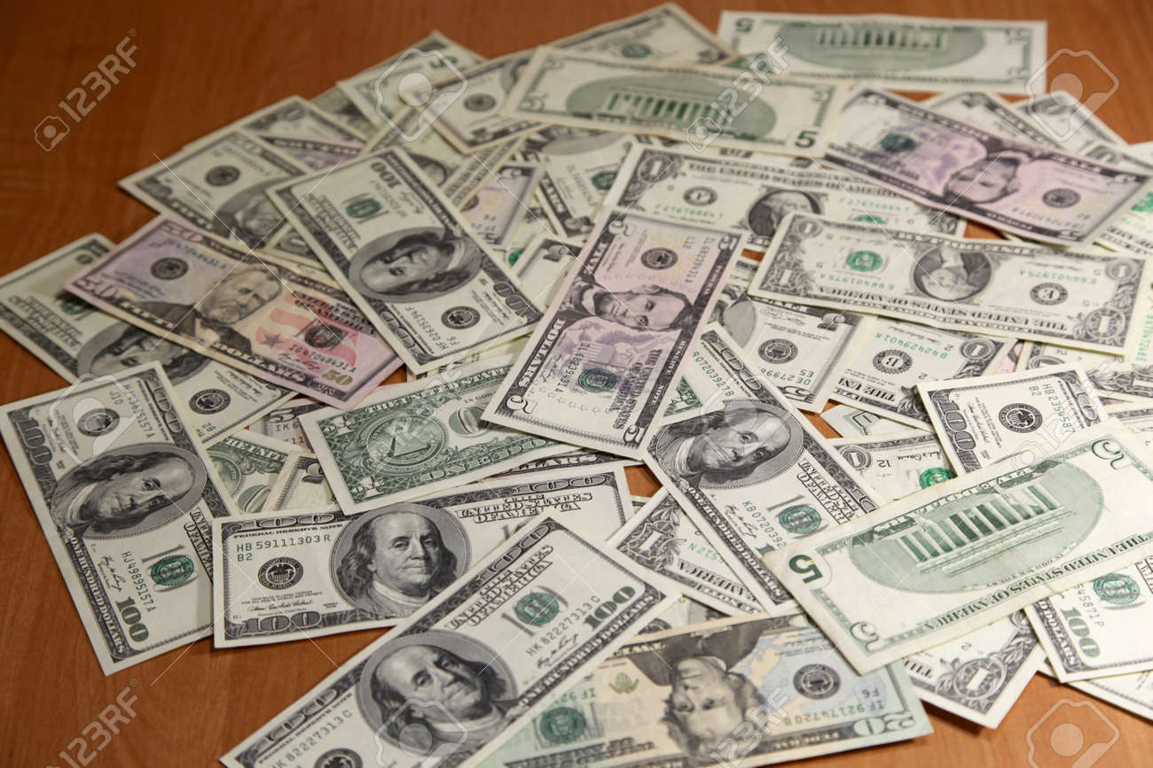 Money in wooden table Stock Photo - 11376225