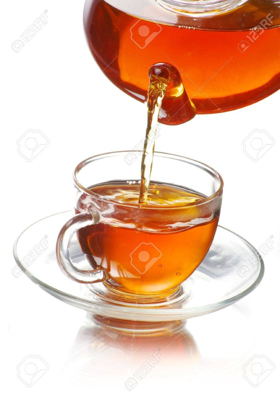 tea being poured into glass tea cup - 9188915