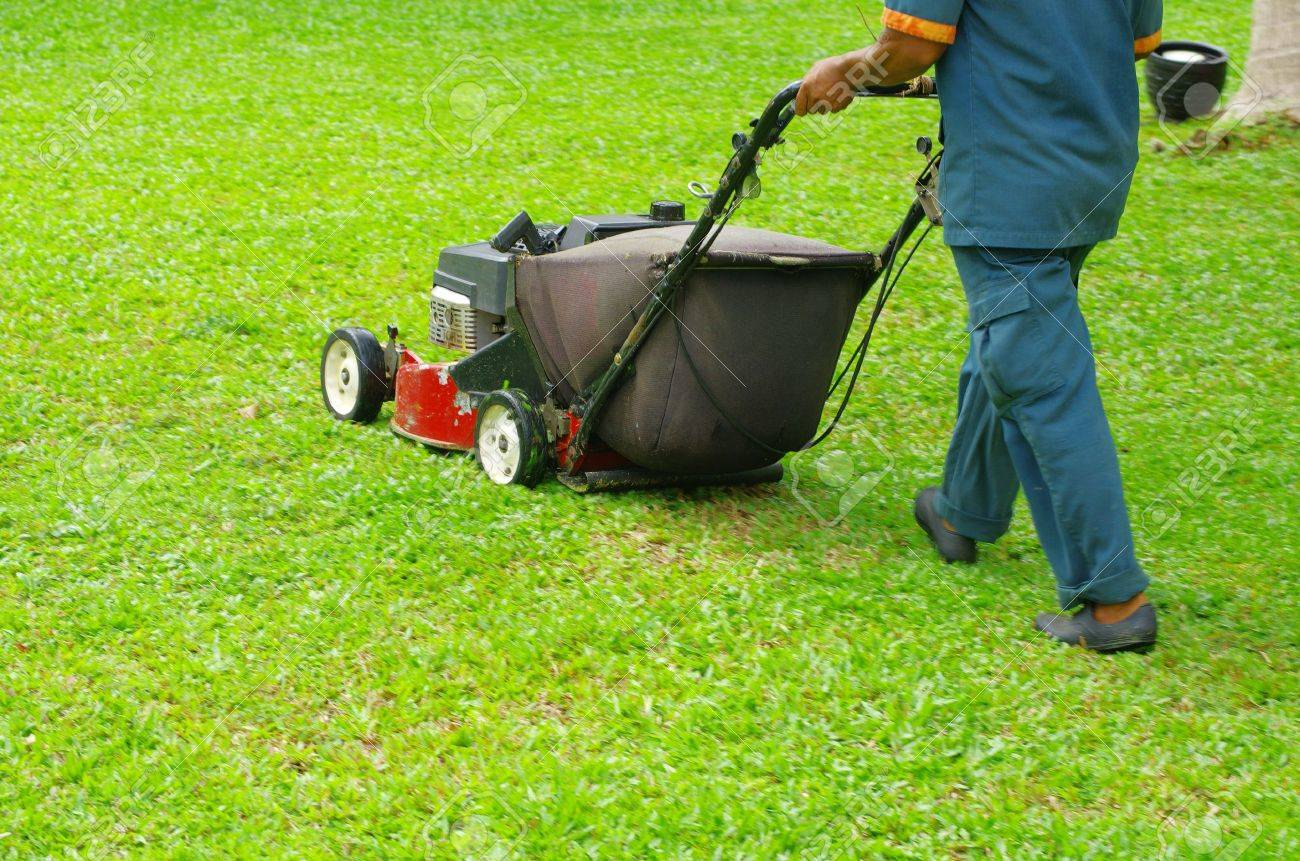 A man mowing the lawn Stock Photo - 12982638