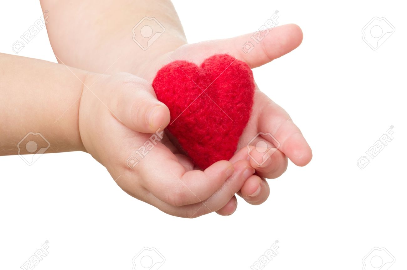 Child's hands with a red heart Stock Photo - 16109600