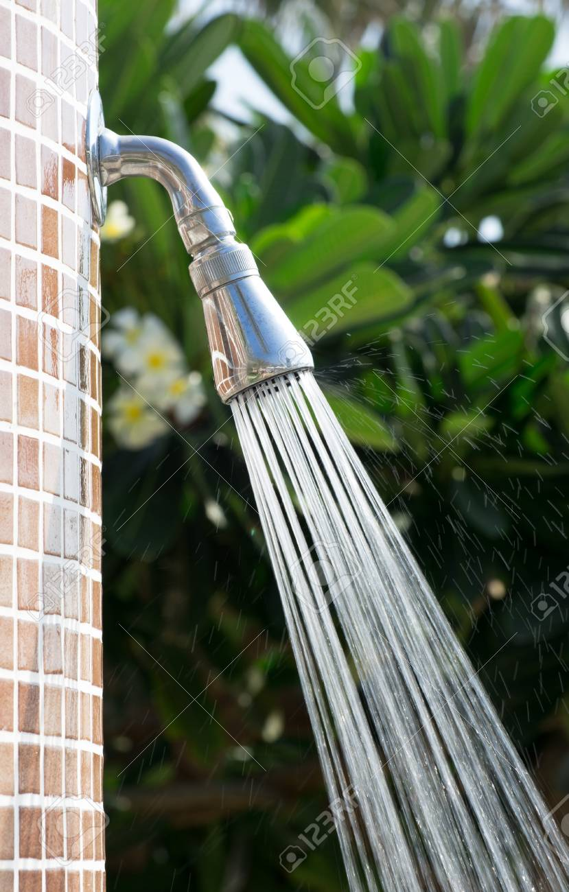 Tropical refreshing shower under palm trees Stock Photo - 16596416