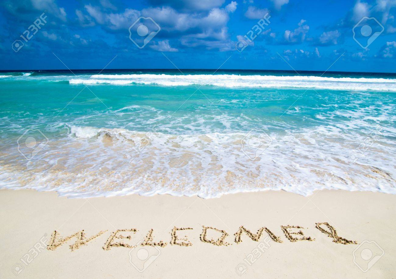 welcome written in a sandy tropical beach Stock Photo - 18249676