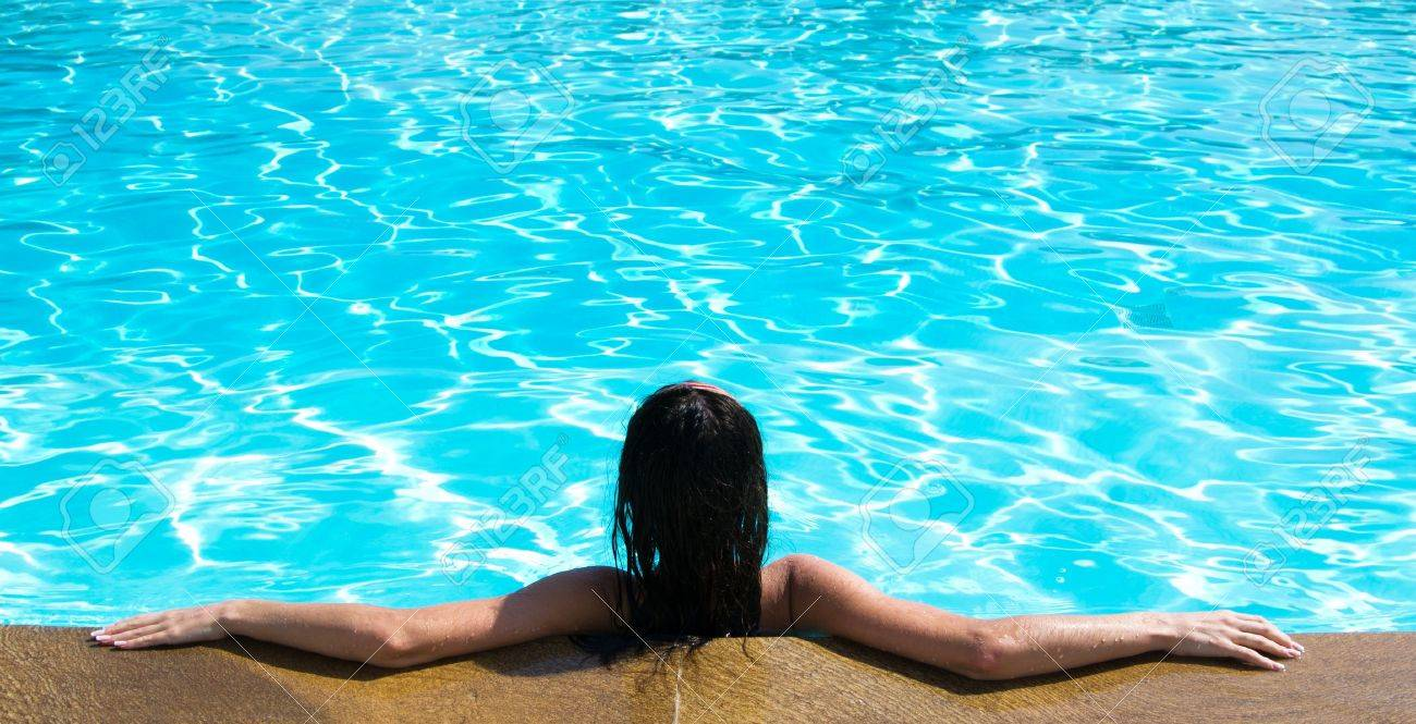 Portrait of young woman sitting in swimming pool Stock Photo - 18510649